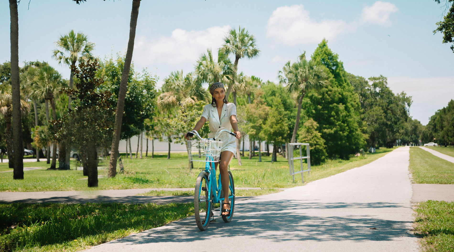 Smiling woman riding a bicycle Serena by the Sea